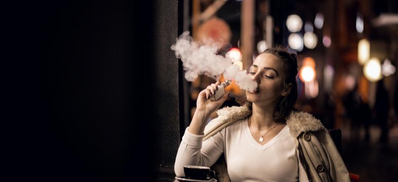 Woman vaping herbs